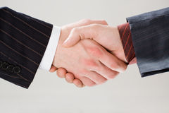 Shaking hands. Image of shaking hands making an agreement on the white background royalty free stock image