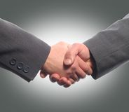 Shaking hands. Two businessman shaking hands in gray background Stock Photo