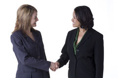 Shaking hands. Two confident businesswoman shaking hands Royalty Free Stock Photo