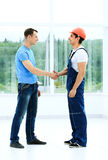 Shaking Hands With Builder Royalty Free Stock Photos