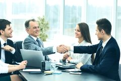 Business partners to discuss cooperation plan for the workplace. Shaking hands during a business meeting business partners in the office Royalty Free Stock Photography