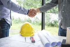 Shaking hands of collaboration, Construction engineering or arch royalty free stock photo