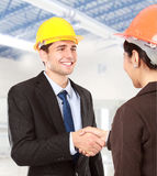 Shaking hands at construction site Royalty Free Stock Image