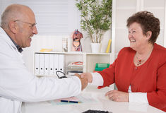 Shaking hands at doctor with senior patient. Stock Images