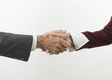 Shaking hands while doing business. Businessman and woman's hand shaking over business deal or meeting Stock Photos