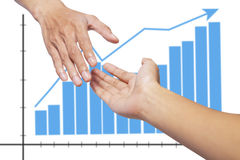 Shaking hands in front of graph Stock Photo