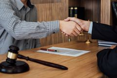 Shaking hands after good cooperation, Businessman handshake male lawyer after discussing good deal of contract, Meeting and stock photo