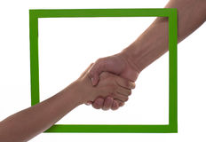 Shaking hands in a green photo frame Stock Images