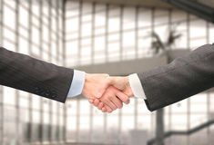 Shaking hands in hall of business center Royalty Free Stock Photography