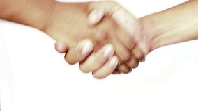 Shaking hands. On isolated background stock footage