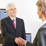 Shaking hands at job interview Royalty Free Stock Photography
