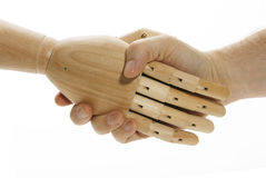 Shaking hands with the machine Royalty Free Stock Photography