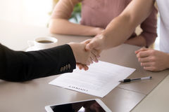 Shaking hands making deal, family mortgage, loan contract, perso. Male customer and female insurance broker shaking hands, couple and real estate agent Royalty Free Stock Images
