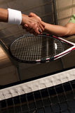 Shaking hands after a match Stock Photography