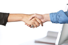 Shaking hands in office Stock Images