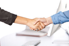 Shaking hands in office Stock Image