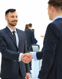 Shaking hands in the office at the beginning of the working day Royalty Free Stock Image