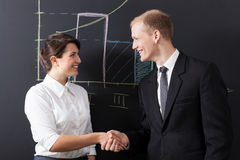 Shaking hands. Portrait of businesswoman and businessman shaking hands stock photo