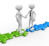Shaking hands on puzzle pieces. Stock Image