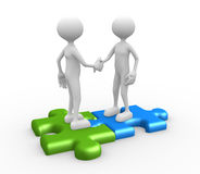 Shaking hands on puzzle pieces Stock Photos