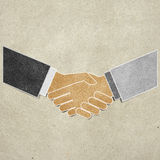 Shaking hands recycled paper Stock Image