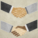 Shaking hands recycled paper craft Stock Images