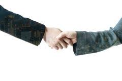 Shaking hands. On white background stock image