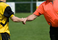 Shaking hands on sport. Two mens shaking hands on sport Royalty Free Stock Images