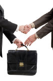 Shaking hands and transfer briefcase Royalty Free Stock Image