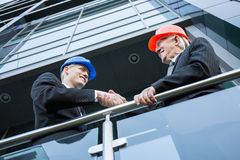Shaking hands. Two elegant architects shaking theris hands fror agreemnt stock photography