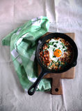 Shakshouka dish in tomato sauce with poached egg and spices Stock Image