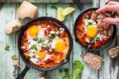 Shakshouka, Fried Eggs in der Tomatensauce Stockfoto