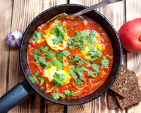 Shakshuka鸡蛋和蕃茄 图库摄影