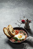 Shakshuka in a cast iron skillet Royalty Free Stock Photography