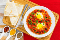 Shakshuka - eggs,bell pepper, chili, tomato sauce and spices Stock Images