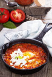 Shakshuka with tomatoes and eggs Stock Images