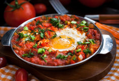 Shakshuka with tomatoes and eggs Royalty Free Stock Photography