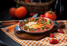 Shakshuka with tomatoes and eggs Royalty Free Stock Photo