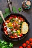 Shakshuka is a traditional breakfast of Israeli cuisine. Eggs fr royalty free stock photo