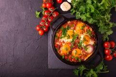 Shakshuka. Traditional Israeli cuisine. Fried eggs with vegetabl Royalty Free Stock Image