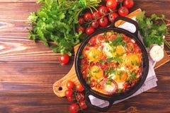 Shakshuka. Traditional Israeli cuisine. Fried eggs with vegetabl Royalty Free Stock Photos