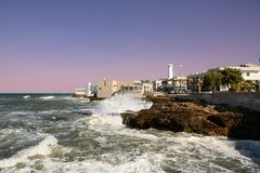 Shaky sea and rocks on the waterfront of Torre Canne Stock Image