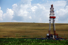 Shale gas drilling rig. Color shot of a shale gas drilling rig on a field Stock Image