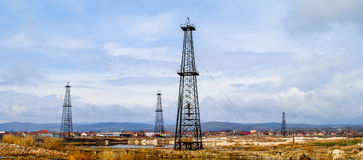 Gas drilling rigs for shale. Shale oil and gas drilling rigs in countryside against blue skies with clouds Stock Photography