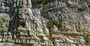 Shale rock outdoors as background. Sunlight Royalty Free Stock Image