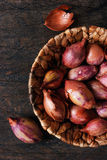 Shallot in a wicker basket Royalty Free Stock Images