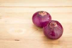 Shallot on wood Royalty Free Stock Images