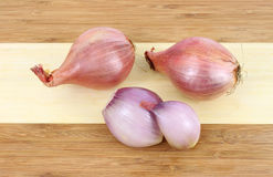 Shallots on cutting board Royalty Free Stock Photo