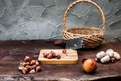 Shallots , Onion , Garlic , Chopping board and Knife with Basket Stock Images