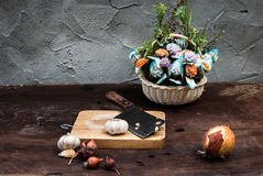 Shallots , Onion , Garlic , Chopping board and Knife with Flower Stock Image